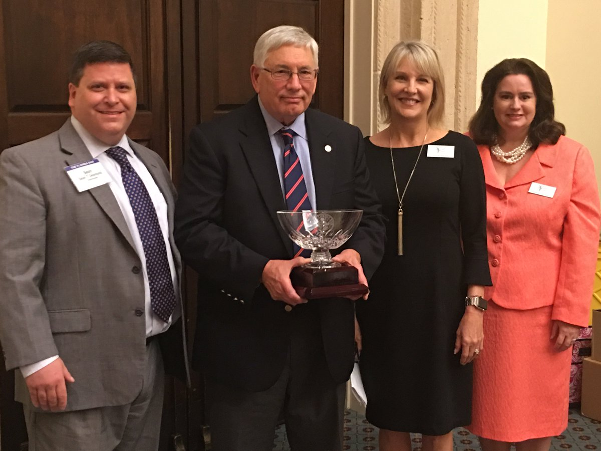 Section Chair Sean Desmond, Tradition of Excellence Award recipient Bruce Robinson, and former Section Chairs Teresa Byrd Morgan and Jennifer Dietz