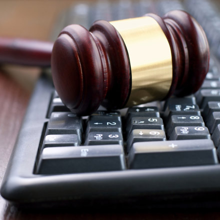 Image of a gavel on a computer keyboard